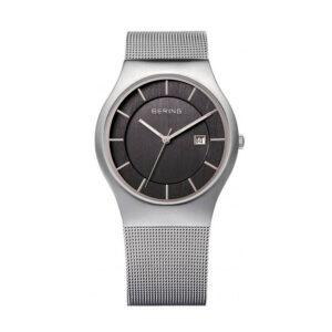 Reloj Bering Sale Hombre 11938-002 Acero plata pulido esfera negra agujas neón y correa malla milanesa